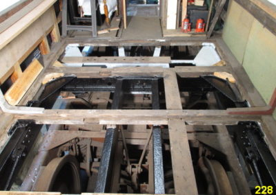 Frames exposed beneath the floor to enable corrosion protection work.