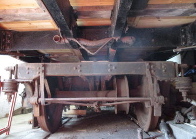 Stripped out underside of Barnum no.228 – revealing space for missing brake actuation gear, dynamo, and the bogie which needs major overhaul. Photo – Andrew Coalwood